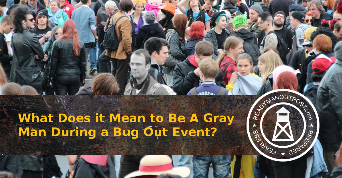 A Man Colored Gray In A Crowd Of People To Depict A Gray Man In A Bug Out Event..